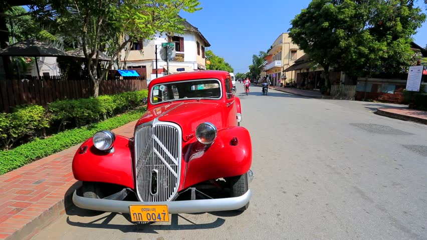 LUANG PRABANG, LAOS - CIRCA JAN 2014: Old classic car on the street, on circa January, 2014,  Luang Prabang, Laos.  Luang Prabang is a UNESCO World Heritage Site.