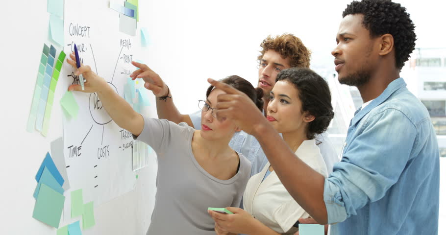 Creative team brainstorming together in creative office | Shutterstock HD Video #5653745