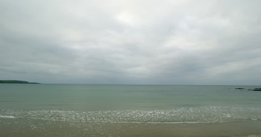 Tranquil beach scene on a cloudy day