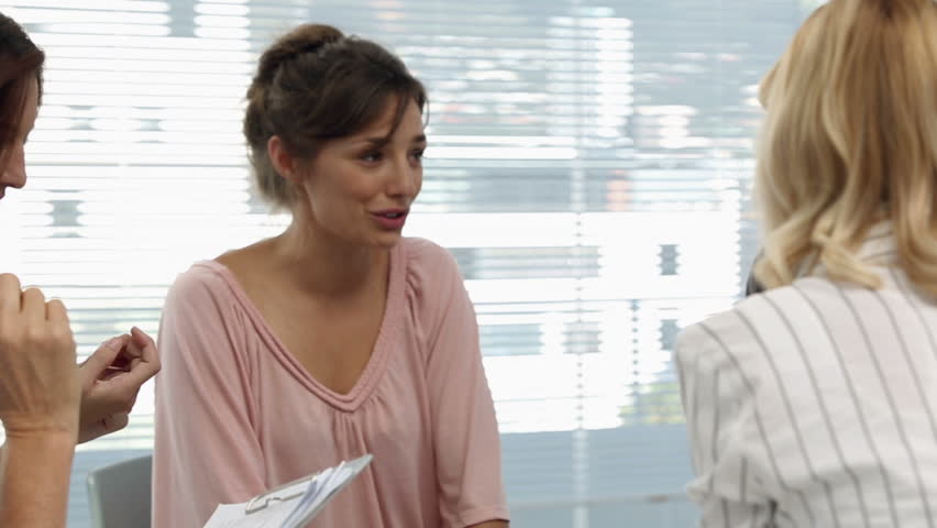 Businesswomen having a conversation after a seminar in office | Shutterstock HD Video #5662421