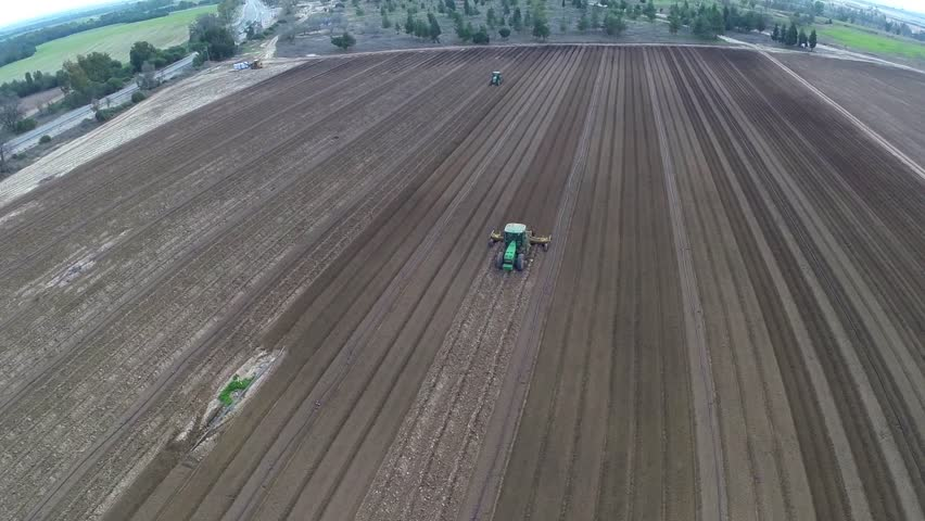 Flight over Potato field Beautiful Aerial view of Tractor works on the field