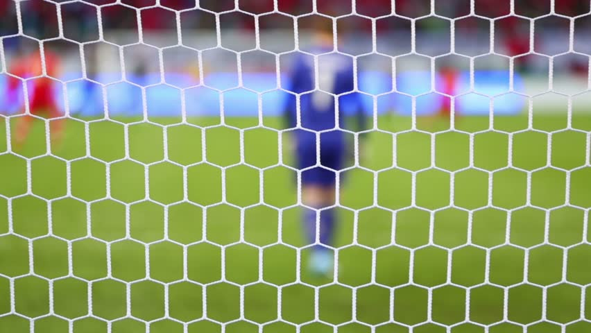 White football grid, back of goalkeeper and other players on match. Focus on grid   Shutterstock HD Video #5694005