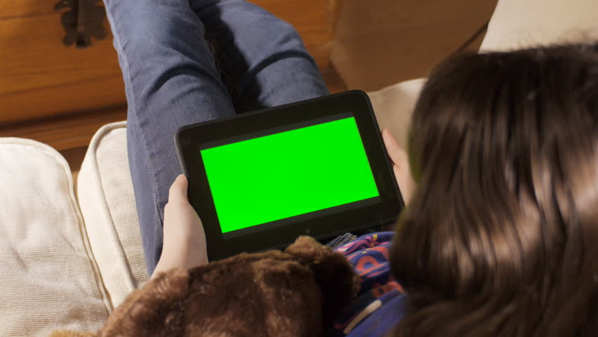 Little girl with tablet PC, green screen