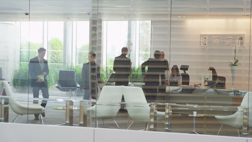 Diverse group of city business people in reception area of large modern corporate building. In slow motion. #5699942