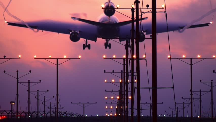 Airplane jet plane landing in airport at sunset. Slow motion. | Shutterstock HD Video #5721095