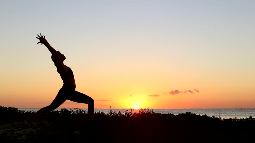 Stock Video Of Silhouette Woman Doing Warrior Yoga Pose