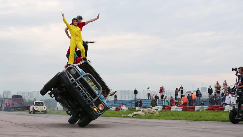 MOSCOW, RUSSIA - AUG 25, 2012: Stunts stand on car riding on two wheels at Festival of art and film stunt Prometheus in Tushino. Festival was organized in 1998.