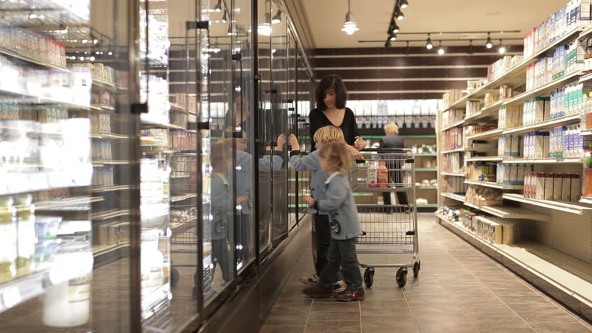 Mother shopping with children in grocery store | Shutterstock HD Video #5763395
