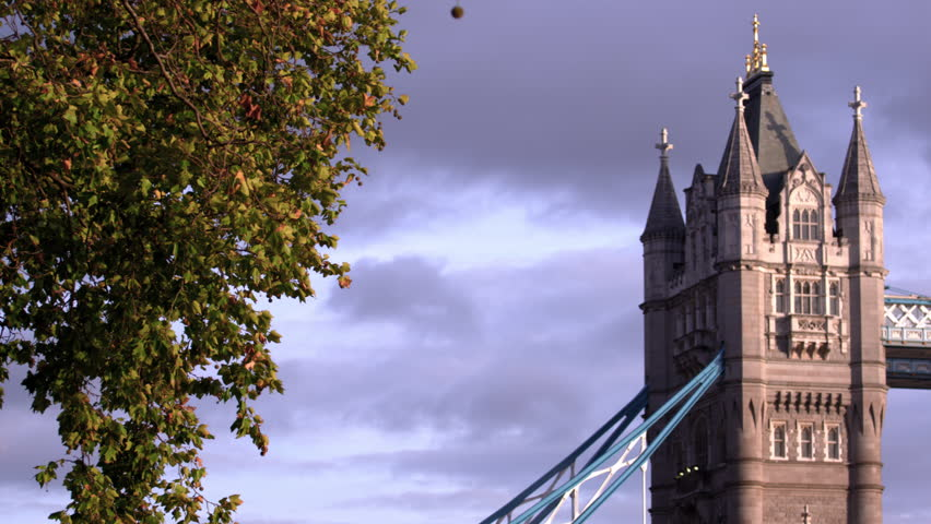 Panning view of tops of towers on Tower Bridge in London, England