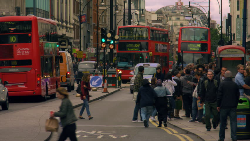 LONDON, UK - OCTOBER 8, 2011: Cars, people and double-deckers in slow motion.