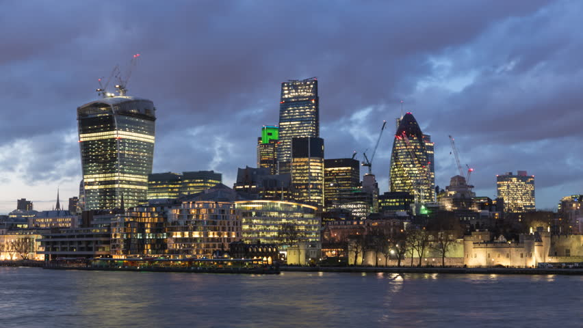 The City of London Financial District, London, England. A day to night transition time lapse. Towers include 20 Fenchurch Street known as the Walkie Talkie and 30 St Mary Axe known as the Gherkin.
