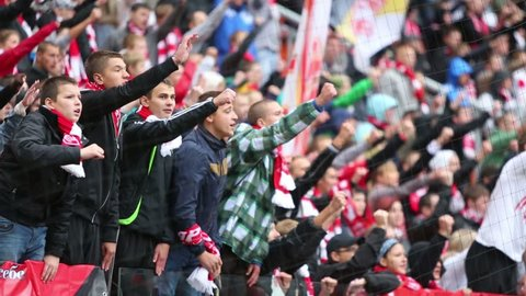 MOSCOW, RUSSIA - SEP 9, 2012: Young fans shout at football match Spartak Moscow - Dynamo Kiev at Lokomotiv stadium.