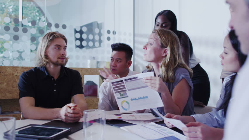 Attractive mixed ethnicity business team in a boardroom meeting. | Shutterstock HD Video #5847155