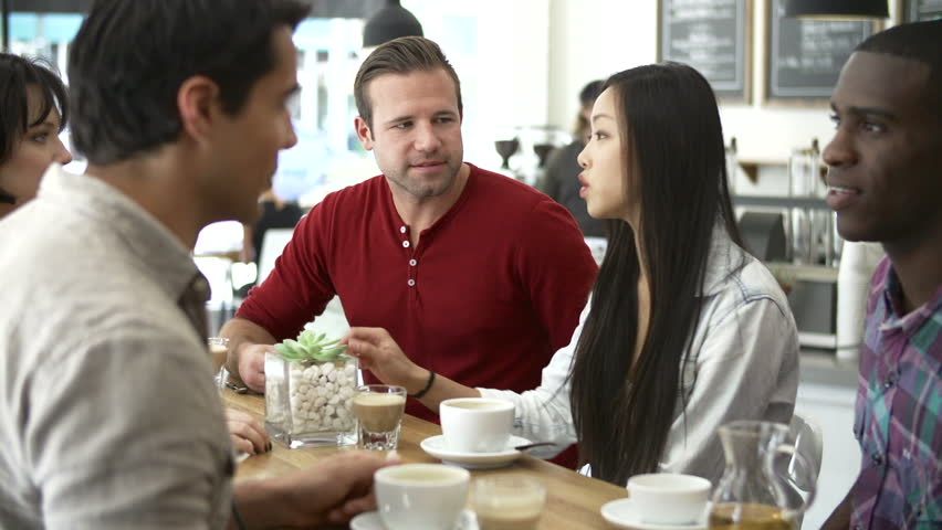Group of friends sitting at table in cafe chatting.Shot on Sony FS700 in PAL format at a frame rate of 25fps | Shutterstock HD Video #5878055