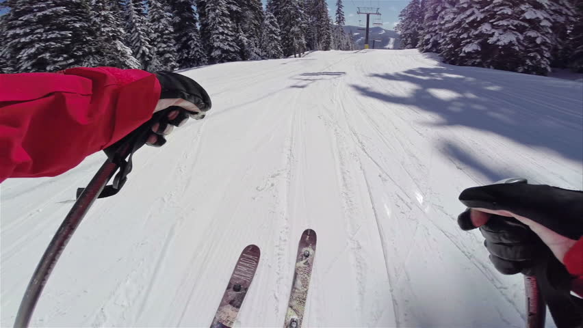Skier Rips Down Groomed Slopes of Mountain with Head Mounted Point of View Camera During a Clear Beautiful Day of Skiing with Snowy Trees on the Side with Sound 1080 HD Video POV Sunny Action