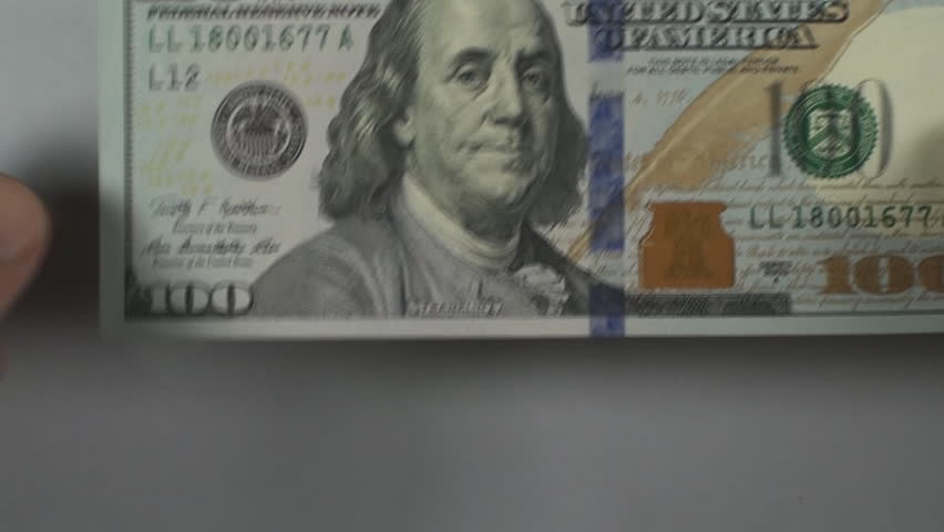 Man Playing With The New 100 Dollar Bill Point Of View   Shutterstock HD Video #5894525