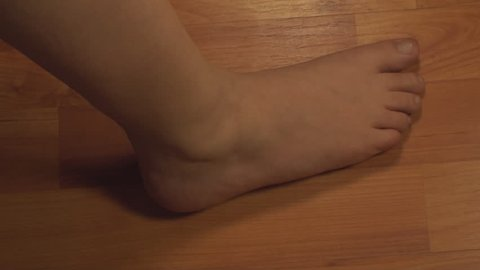Woman Massaging Ankle, Ankle Injury, Pain, Treatment, Medical, Side-Shot