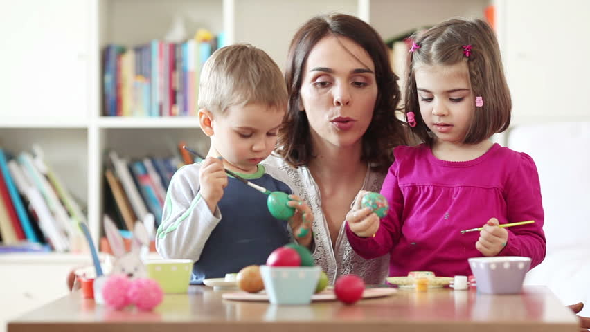 Kids painting Easter eggs with their mother | Shutterstock Video #5952953