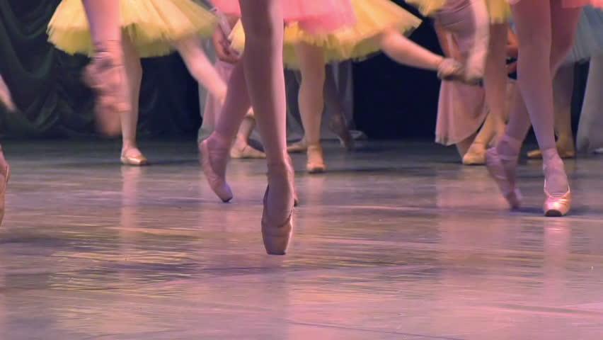 Ballet Troupe. Feet in pointe dancing ballerinas on the stage. Slow Motion at a rate of 120 fps