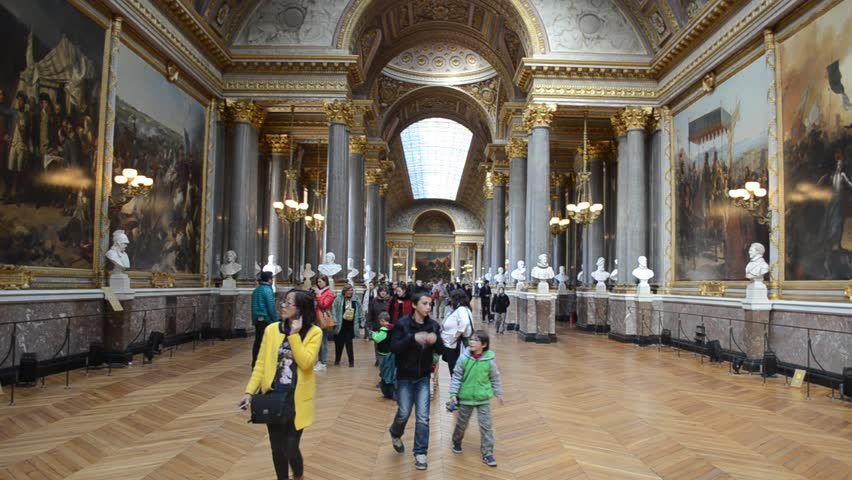PARIS, FRANCE, MARCH 22, 2014: People are strolling through galleries of Palace of Versailles in Paris.