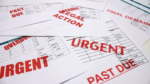 Credit crunch debt and recession. Tracking over past due and overdue invoices and bills for urgent payment. Final demands and legal action.