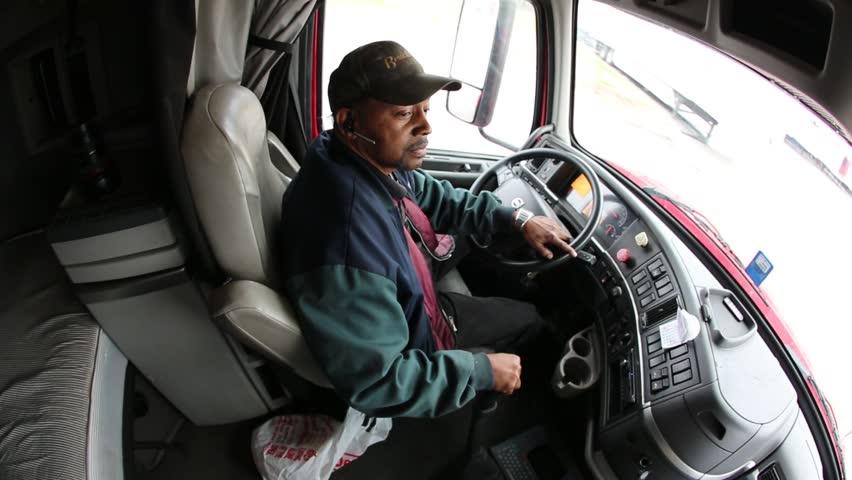 Dallas, Texas, Circa 2014: Truck driver of tractor trailer positions truck for unloading in Dallas, Texas, Circa 2014