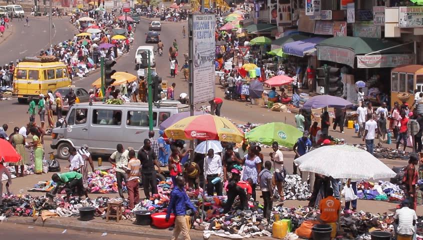 KUMASI, GHANA AFRICA  - MAY 2013, camera pans, people buying in selling