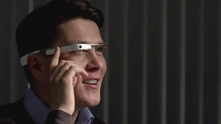 Close up of man using smart glasses and gesturing