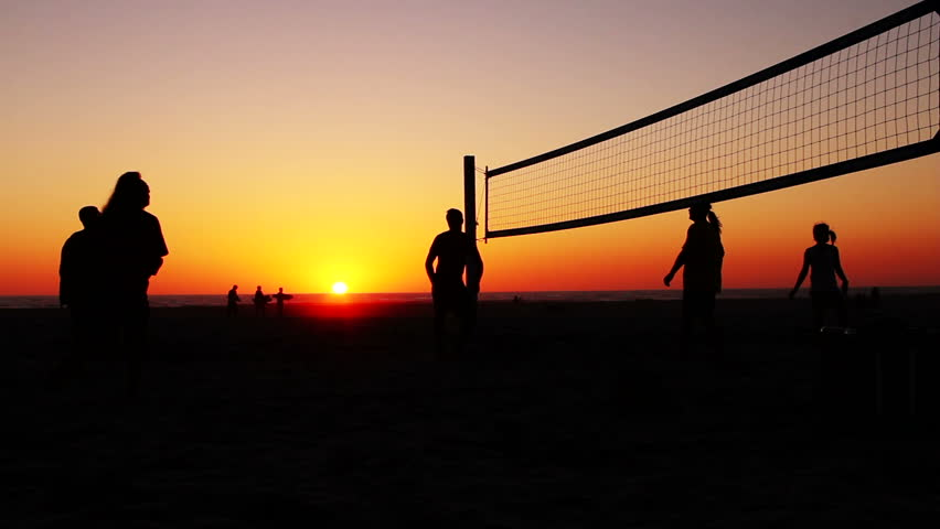 Sunset Silhouette People Playing Volleyball Stock Footage