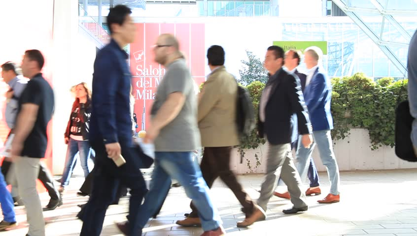 MILANO, ITALY - APRIL 10, 2014: People walk to the pavilions under the Fiera gallery to Salone del Mobile, international home furnishing and accessories design exhibition in Milano, Italy.  | Shutterstock HD Video #6080399