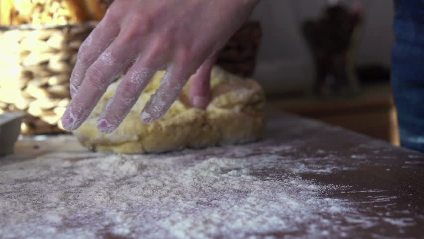 throwing and kneading dough on table, super slow motion, shot at 240fps