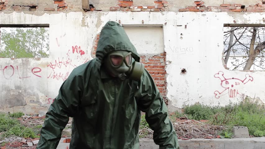 Man with gas mask and decontamination suit coming out from basement in ruined building,protective clothes,looking around,exploring and searching,abstract shot apocalypse,tilt up,cinematic look, 25fps. #6087365