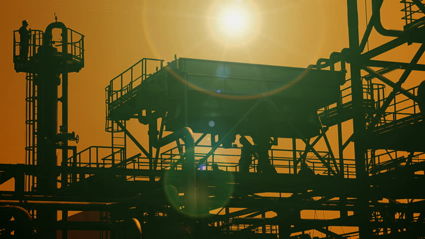 Oil platform ; Industrial plants for the production and processing of oil and gas,silhouette at sunset,video clip