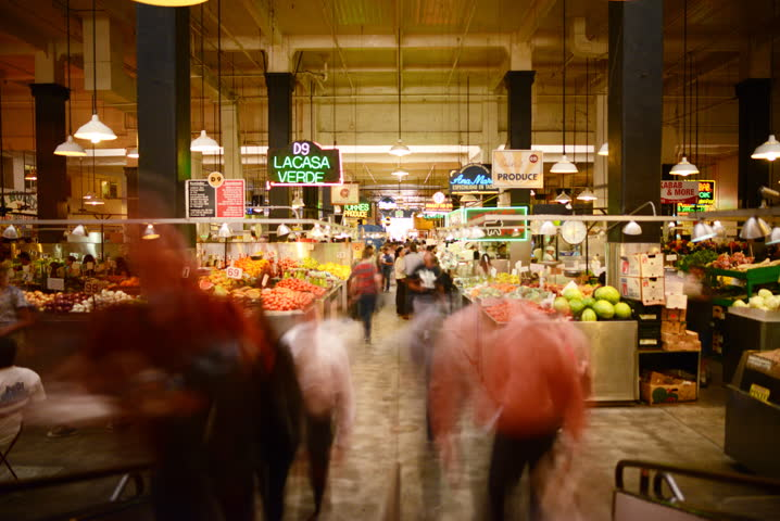 LOS ANGELES, California - April 9th: 6K Full Frame time lapse Photography of unrecognizable shoppers gather at historic Grand Central Market in Downtown Los Angeles on April 9th.