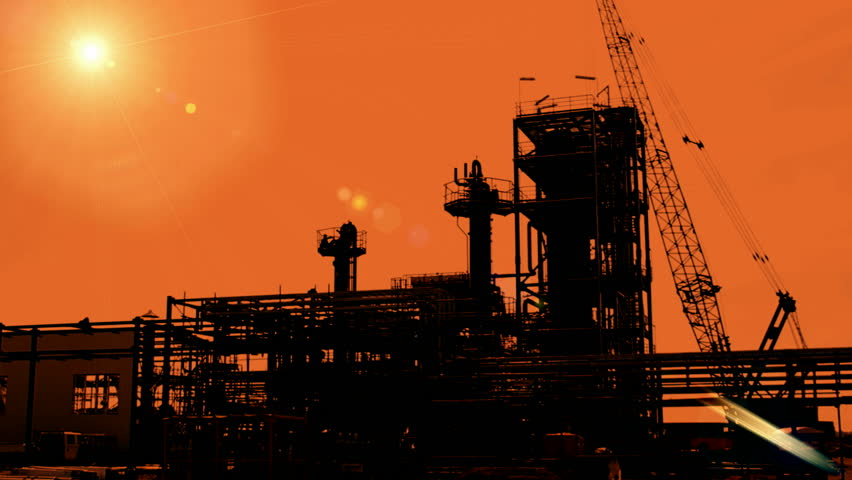 Construction of petroleum facilities ; Industrial plants for the production and processing of oil and gas,silhouette at sunset,video clip