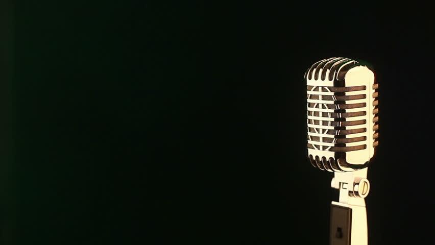 Golden vintage microphone loop rotate on black background - Microphone wallpaper ...