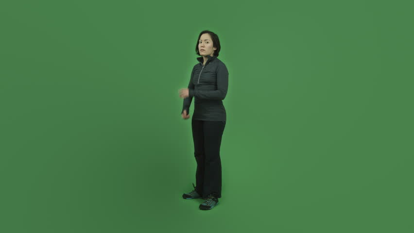 Caucasian sporty girl young adult in her 30s isolated on chroma green screen background upset anger | Shutterstock HD Video #6186665