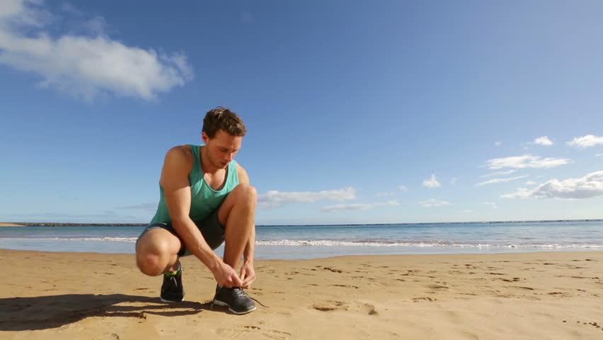 Funny video man jogging on beach