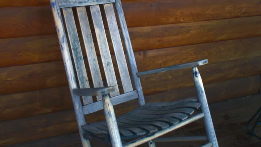vintage weathered rocking chair on outdoor porch