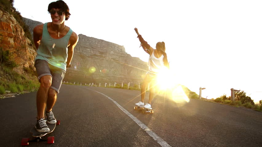 Friends longboard skating on road sunset | Shutterstock Video #6253583