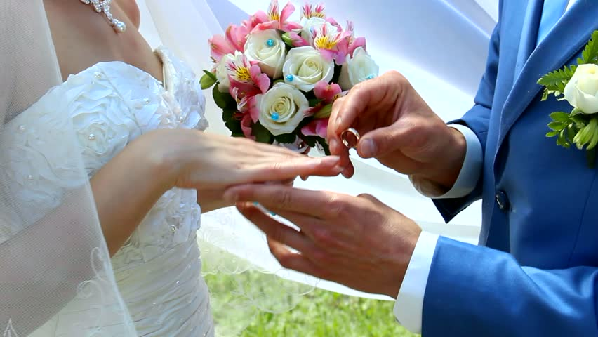 On A Wedding Day Groom Puts A Wedding Ring On Finger Of A Bride