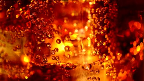 Cola background. Cola with Ice and bubbles in glass. Food background. Stock full HD video footage 1920x1080