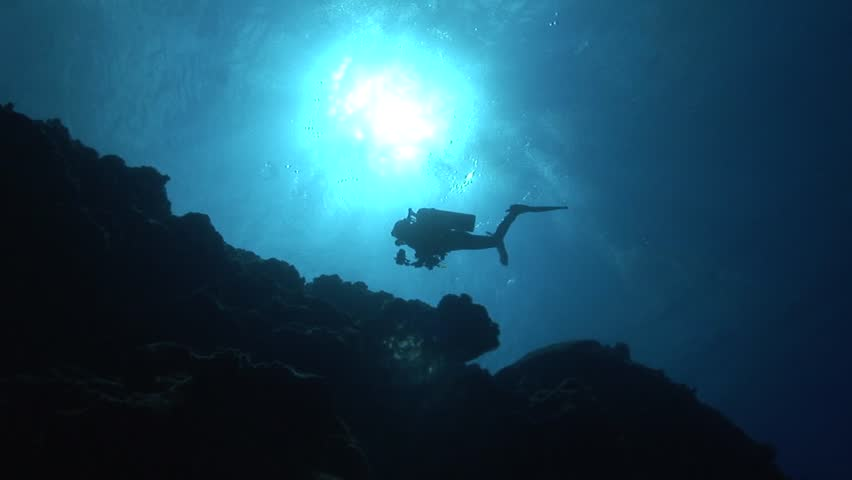 Divers in backlight in crystal clear water | Shutterstock HD Video #6271700