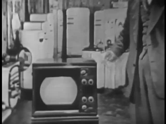 Man placing his hand on retro TV