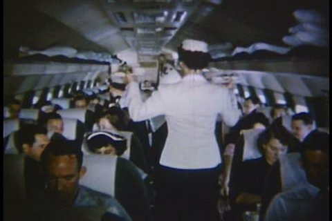 CIRCA 1950s - Arthur Godfrey smokes cigarettes in the cockpit with the [pilots of the new Eastern Airlines Constellation in 1953.