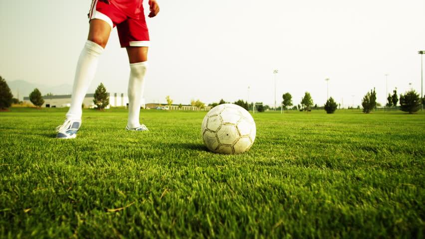 Medium Shot Close Up Two soccer players playing soccer on field, Orem, Utah, USA