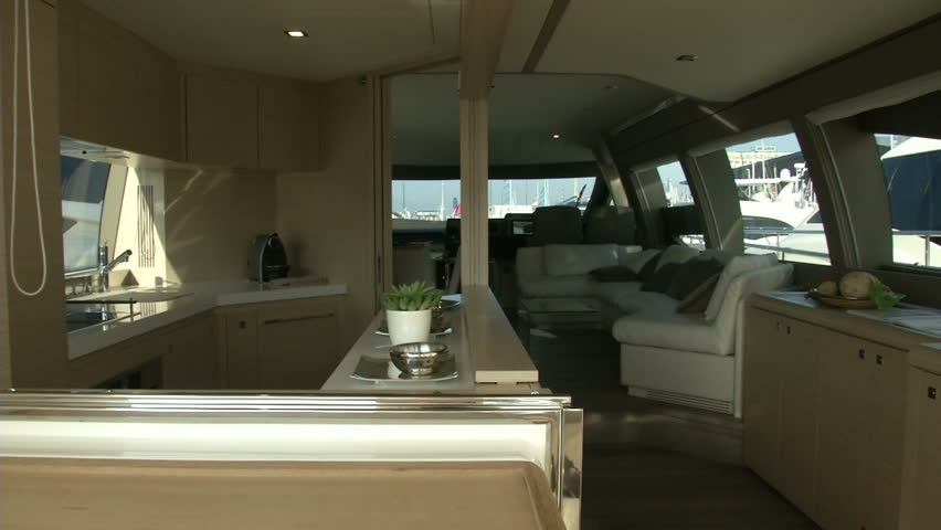 Main deck on luxury yacht, with view of living room, cockpit and kitchen  | Shutterstock HD Video #6300635