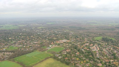 Properties flooded by recent rain storms - Aerial view rural Southwest England residential homes and farmland Surrey west of London, UK