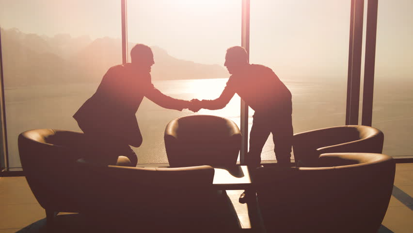 Handshaking businessman. meeting. businessman conversation. discussion talking. silhouette. business background. company career corporate. cooperation. professionals. sunset sun flare. luxury interior | Shutterstock HD Video #6344366