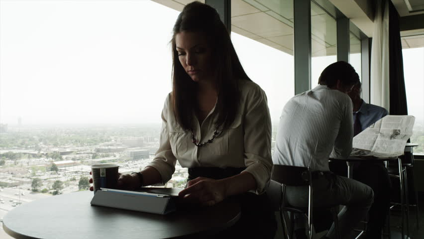 Medium Shot Pan Business woman using digital tablet sitting by window in cafe | Shutterstock HD Video #6351005
